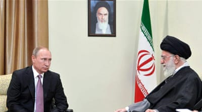 The Iranian supreme leader called for closer ties between his country and Russia as Putin visited Tehran on Monday [EPA]