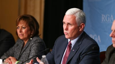Pence is one of 31 governors who oppose the resettlement of refugees within their states [Michael Conroy/AP]