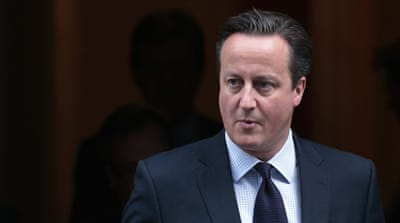 "Cameron said the UK must expand anti-ISIL air strikes to Syria to deny the group a ""safe haven"" [Suzanne Plunkett/Reuters]"
