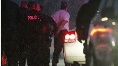 The handcuffed gunman is moved to a police vehicle in Colorado Springs [Rick Wilking/Reuters]