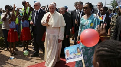 Francis ends his Africa tour with a Mass for thousands of Catholics at the country's national stadium [EPA]