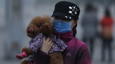 China raises alert level as thick smog engulfs Beijing