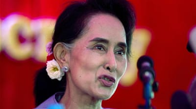Myanmar's opposition leader Aung San Suu Kyi delivers a speech during a campaign rally [Gemunu Amarasinghe/AP]