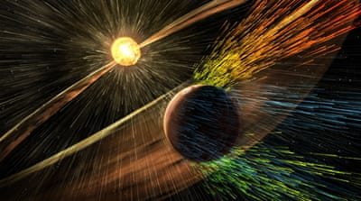 Earth's strong magnetic field seals in our own atmosphere, preventing direct erosion by the solar wind [Goddard Space Flight Center/NASA via AP]