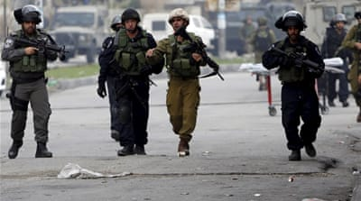 Israeli forces have shot dead 72-year-old Thawarat Ashrawi while she was driving her car into the gas station [EPA]