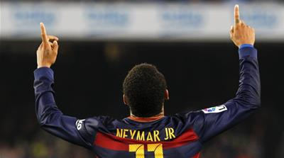 Neymar's double takes Barcelona top of the league