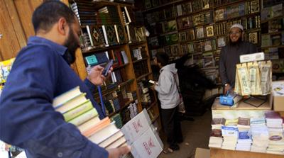 An Egyptian selects some books at a bookstore in Cairo, Egypt [Getty]