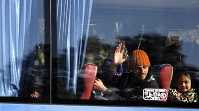 Syria rebels leave Homs following rare ceasefire deal