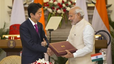 Abe and Modi are economic reformers who have forged an unusually close relationship [Manish Swarup/AP]