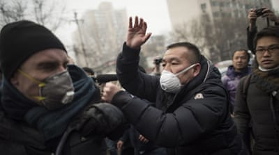Scuffles as celebrated lawyer goes on trial in China