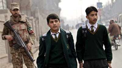 No end to Pakistan school's trauma, one year on