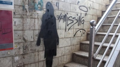 Shadows of missing girls have been painted on more than 200 walls in nine Indian cities [Priti Salian/Al Jazeera]