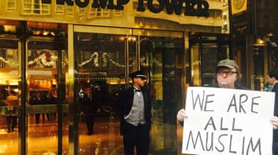 Michael Moore in front of Trump Tower in New York City [Michael Moore's Facebook page]