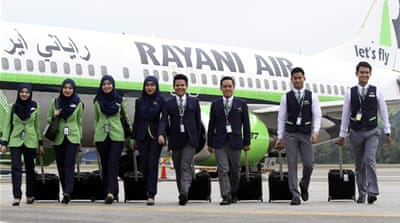Aceh requires Muslim air hostesses to wear hijab
