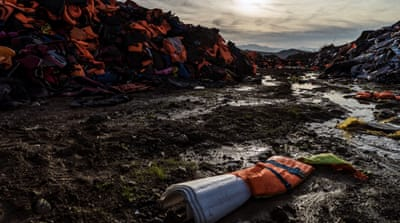 Life vests, dinghies and debris are strewn along the shores of Lesbos [Sorin Furcoi/Al Jazeera]