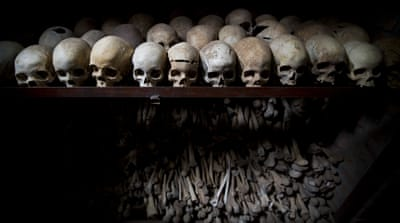 Skulls and bones of some of those killed during the 1994 genocide in Rwanda [Ben Curtis/AP]