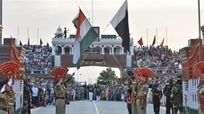 A daily retreat ceremony at the India-Pakistan joint border check post of Attari-Wagah has been suspended [File AP Photo/Prabhjot Gill]