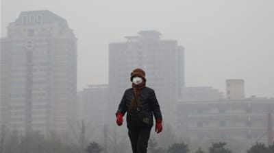 Most of China's greenhouse gas emissions come from burning coal for electricity and heating, which peaks in winter [Reuters]