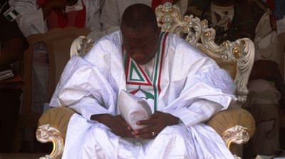 Goodluck Jonathan prays during a rally in Kano [AFP]