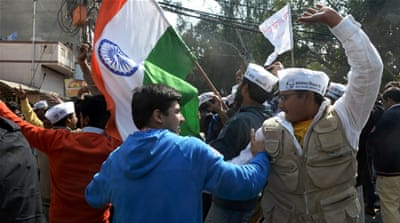 With early trends giving the party a massive lead, hundreds of AAP supporters started celebrations on the streets [AP]