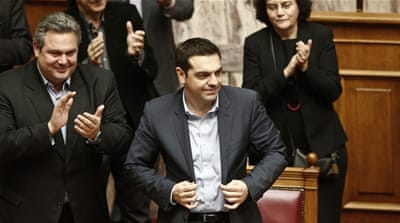 Greece's Prime Minister Alexis Tsipras (R) in conversation at parliament in Athens [EPA]