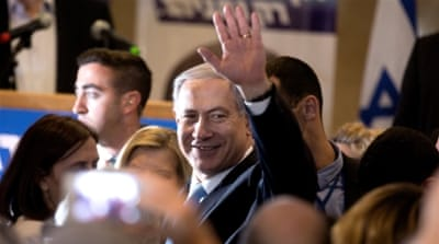 Netanyahu is between a rock and a hard place, writes Bishara [AFP]