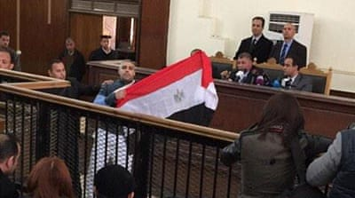 Al Jazeera staff face Cairo court in retrial