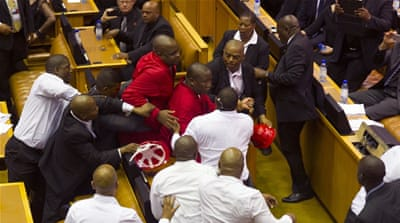 The speaker's order that the protesting MPs be forced out of the building prompted a brawl [AP]