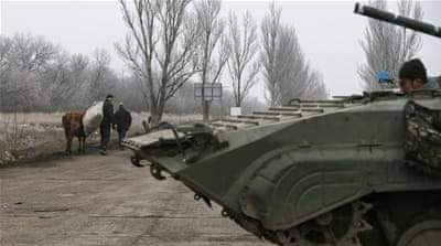 Ukraine ceasefire comes into force after heavy shelling