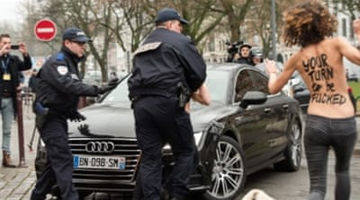 Dominique Strauss-Kahn, center, arrives at the Lille courthouse [AP]