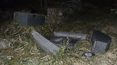 Local media said about 200 grave stones were knocked down, and a monument to Holocaust victims damaged [AFP]
