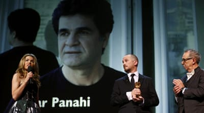 Panahi's niece accepts the Golden Bear for Best Film on his behalf [Reuters]