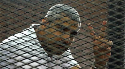 Al Jazeera journalists are falsely accused of colluding with the outlawed Muslim Brotherhood [AP]
