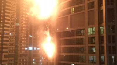 The fire reportedly started on the 50th floor of the Torch, a skyscraper in Dubai's Marina district [AP]