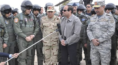 Sisi speaks during a meeting with Egyptian air force personnel near the border of Egypt and Libya [Reuters]