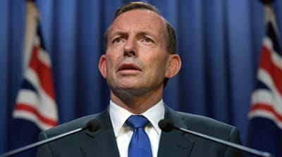 PM Abbott and the country's most senior Muslim, the Grand Mufti Ibrahim Abu Mohammed, are involved in a public spat [AP]