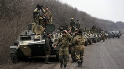 Ukraine begins artillery withdrawal from front-lines