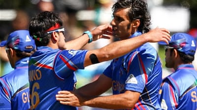 Hassan and Zadran (right) had shared five wickets between them [Getty Images]