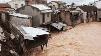 The Sisaony river floods the village of Soavina, a suburb of Antananarivo, after night of torrential rain [AFP]