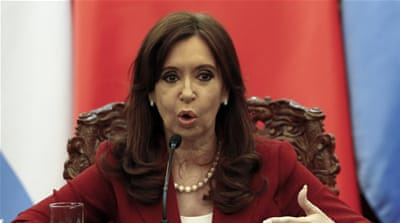 Each court decision has been greeted by supporters and detractors of Kirchner's administration [AP]