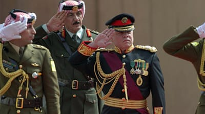 Jordanian King Abdullah II, centre, reviews the honour guard upon his arrival at parliament. [Khalil Mazraawi/AFP/Getty Images]