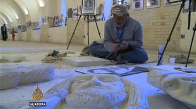 Sculptor Abdullah Doshan said he used to sneak a camera into Mosul's museum to take photos of the statues [Al Jazeera]