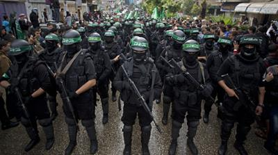 Hamas gunmen display their military skills during a rally to commemorate the group's 27th anniversary in Gaza [AP]