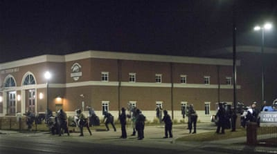 The shooting occurred after several dozen protesters had gathered in front of the Ferguson police department [Reuters]