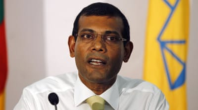 Mohamed Nasheed was dragged into a court building in the Maldives capital Male after being arrested on terrorism charges [AFP]