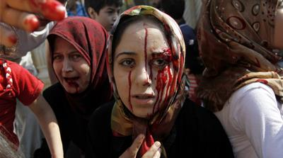 Injured women arrive at a field hospital after an air strike hit their homes in the town of Azaz on the outskirts of Aleppo, Syria. [AP Photo/ Khalil Hamra, File, Aug. 15, 2012]