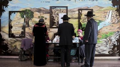 Ultra-Orthodox Jews line up to vote in Bnei Brak, Israel [AP]