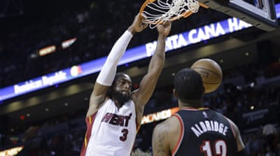 Heat trailed by two points in the final minute [AP]