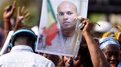 Karim Wade has been in detention since April 2013 over corruption charges [AFP]