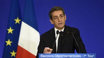 Sarkozy's UMP projected as winner in French local polls